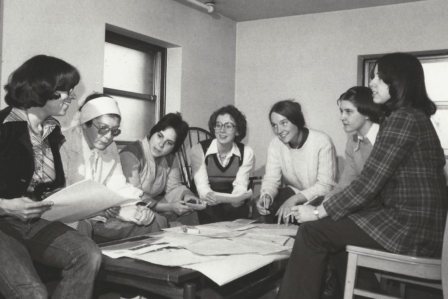 Archival image of women around a table
