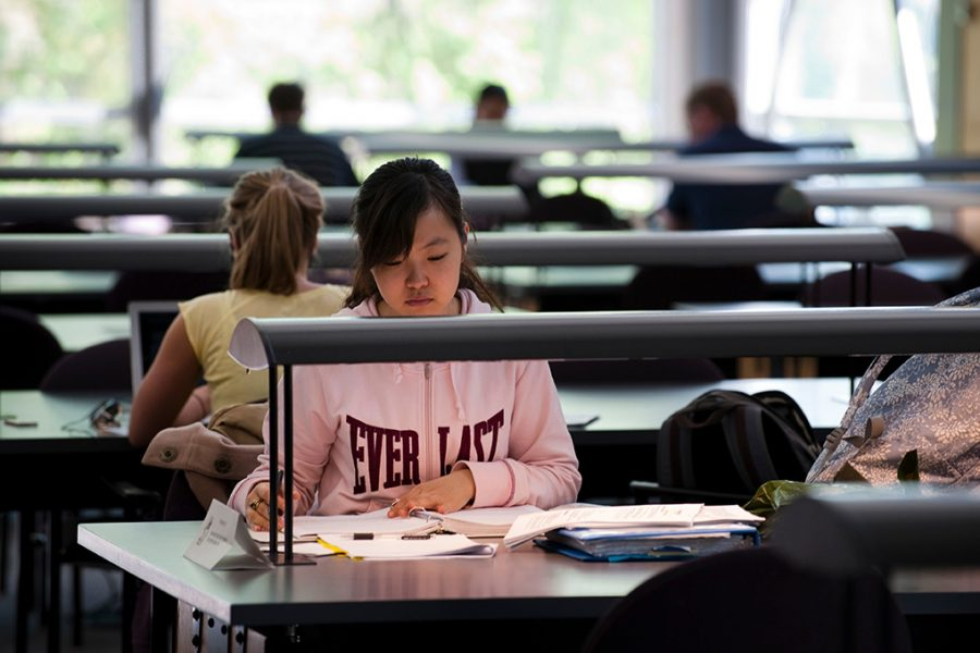 Students studying in Law Library