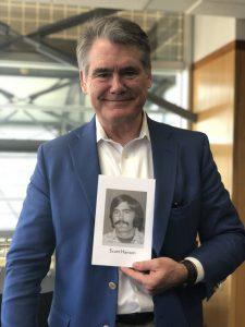 Scott Hansen '76 holds his class exit photo