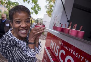 Michelle Behnke '88 samples UW Law's new ice cream, Marberry v. Madison. (Photo by Andy Manis)